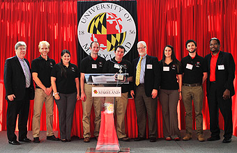 Mark Miller of Sikorsky (4th from right) and J. Michael McQuade of UTC (far left) joined Clark School Dean Darryll Pines (far right) in congratulating the Gamera team members.