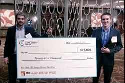 Taylor Myers (left) and Ryan Fisher (right) of MF Fire celebrate winning the $25,000 Energy Efficiency Track Prize at the MIT Clean Energy Prize competition.