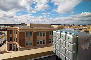 Composite image showing what the Redox Cube would look like installed on a building. Courtesy of Redox/Mtech.