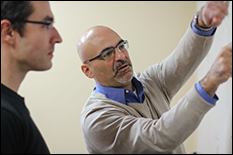 James L. Ulrich (right) works through a problem with MC2 faculty member Charalampos