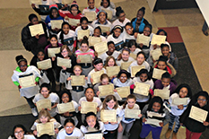 Participants atthe fifthCybersecurity and Cybersafety Workshop for Girls proudly hold up their completion certificates