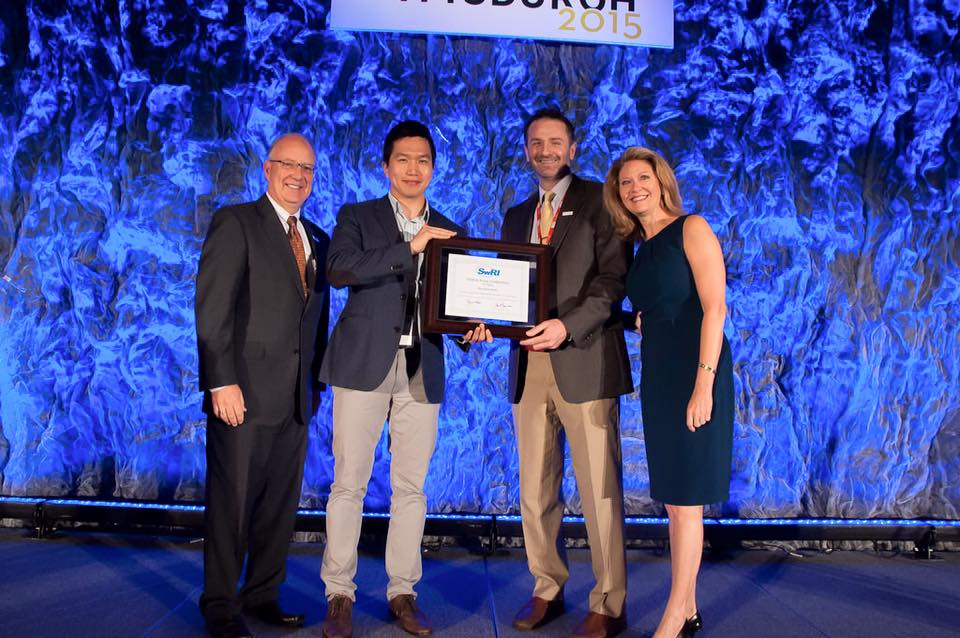 Full size image: Hyoshin Park accepting his award from ITS America