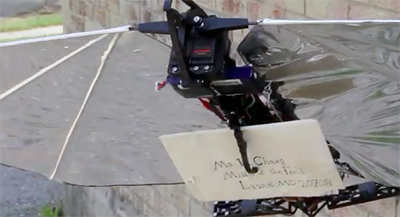 In this still from the latest Robo Raven video, the UAV's new claw grips an important letter to be delivered to a waiting 'Hogwarts' student.