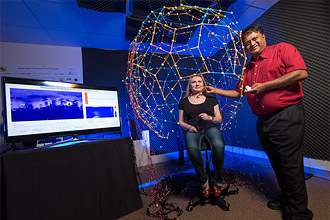 Prof. Ramani Duraiswami (right) with Elena Zotkin, an associate research scientist, in the University of Maryland Institute for Advanced Computer Studies. Photo by John T. Consoli.