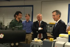 Dr. John Tracy, right, speaks to graduate students and Dr. Inderjit Chopra (center) at the Alfred Gessow Rotorcraft Center.