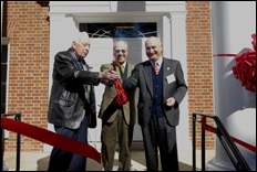 A ribbon-burning marked the opening of the department's new facilities in J. M. Patterson.