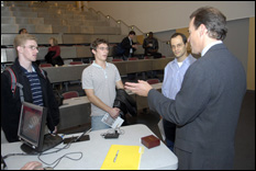 Evan Jones, president and CEO of Digene, speaks with students after the lecture.