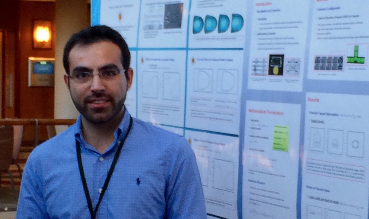 Koolivand beside his poster at the 2016 symposium.