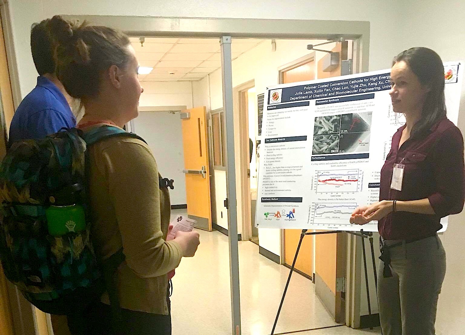 ChBE Undergraduate Julia Lamb discusses her research during the event.