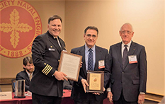 Captain Mark Vandroff (left) of the United States Navy and Glenn L. Martin Institute Professor of Engineering and Professor of Practice Millard S. Firebaugh (right) stand with Dr. Ayyub.