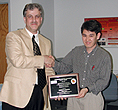 Timothy Horiuchi receives his award plaque from ISR Director Eyad Abed.
