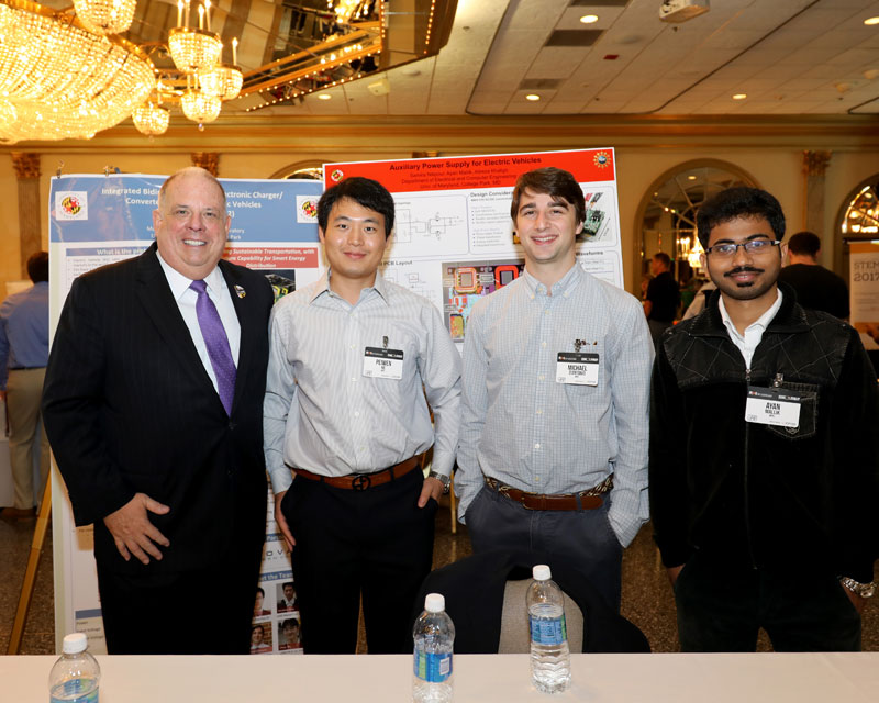 (L-R): Maryland Governor Larry Hogan and UMD Students Peiwen He, Michael D'Antonio, and Ayan Mallik. Photo Credit: Executive Office of the Governor.