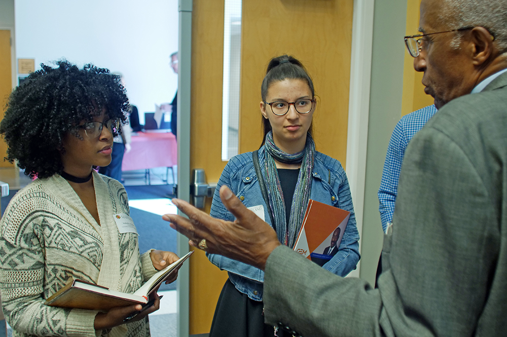 Students talk with Howard G. Adams, former GEM executive director, at the GEM GRAD Lab.