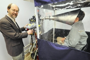 Dr. Donald Milton (left) and a study participant in the Gesundheit II machine, which is used to capture and analyze influenza virus in exhaled breath. Photo provided by the Baltimore Sun.