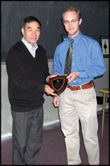 Professor Zhang is presented with his Faculty Appreciation Award by Pi Tau Sigma President Michael Lochner.