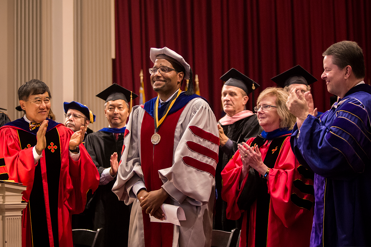 UMD President Wallace Loh (left) and colleagues give Clark School Dean Darryll Pines (center) a standing ovation at the 2018 Faculty and Staff Convocation. Photo: Stephanie Cordle
