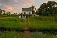 An abandoned home on the Deal Island Peninsula of Maryland's Eastern Shore sits in an area that floods frequently.(Photo by John T. Consoli)