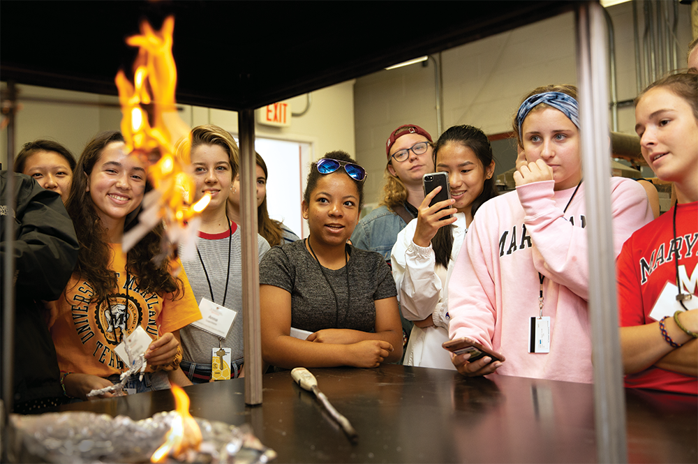 High school students in a WIE summer program get up close to a fire whirl. Photo: Matthew Ehrichs