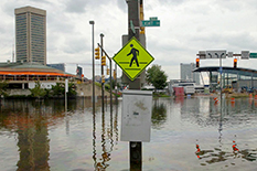 Water covers the streets around the Inner Harbor after downtown Baltimore was flooded by Hurricane Isabel in September 2003.(AP Photo/Gail Burton)