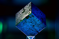 A cube of uranium from a failed German World War II-era nuclear reactor sent doctoral student Miriam Hiebert and Associate Research Professor Tim Koeth on a quest to uncover its history; Koeth (bottom) traveled to Haigerloch, a small town in Germany where scientists tried to start a reactor in a cave beneath a castle.(Photos by John T. Consoli; black-and-white photo courtesy of Tim Koeth)