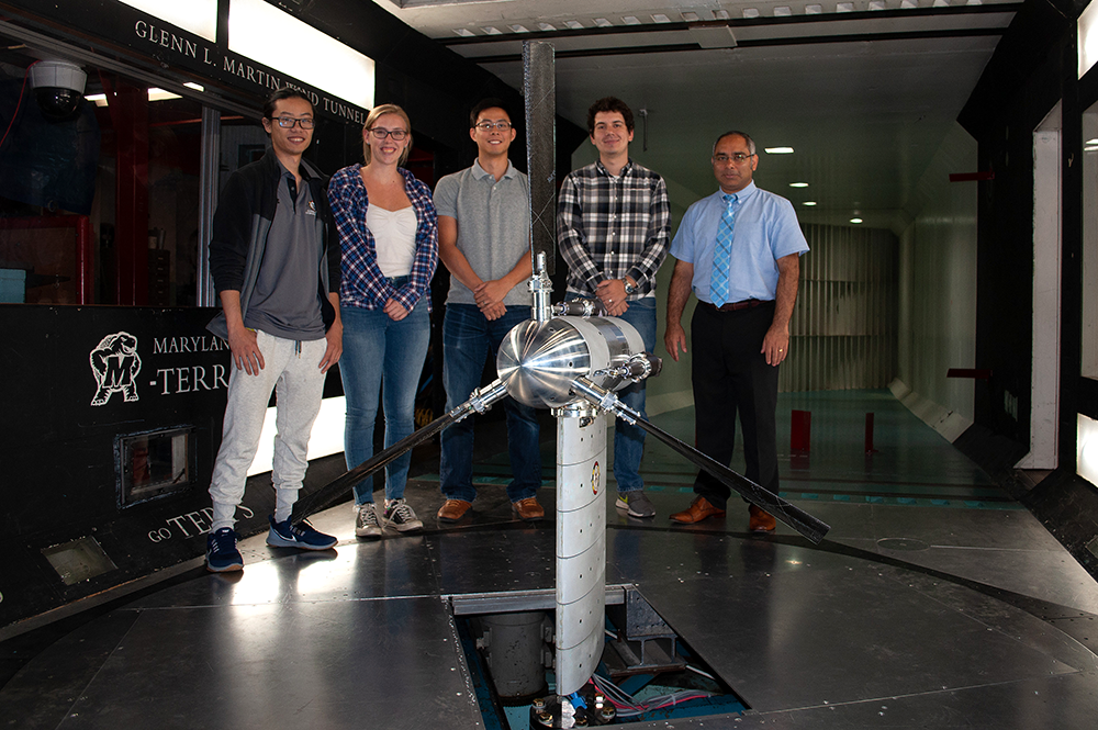 Dr. Anubhav Datta (far right) and students with the Maryland Tiltrotor Rig (MTR) inside of the Glenn L. Martin Wind Tunnel. The MTR is used to facilitate eVTOL and other research.
