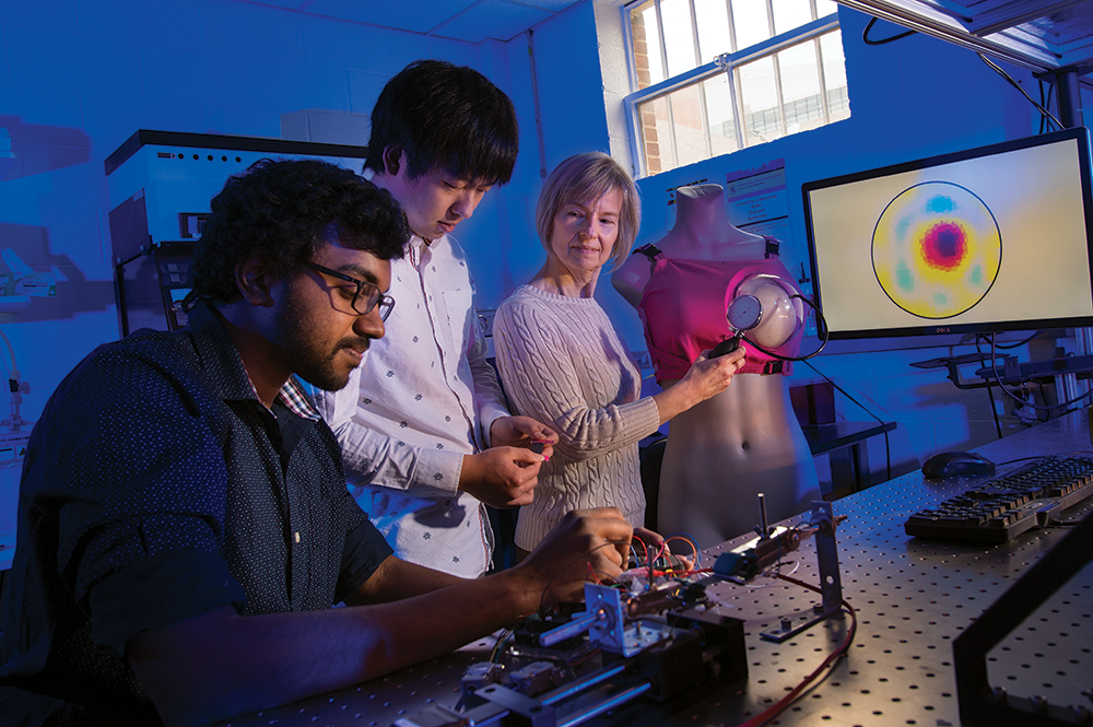 From left to right: Master's student Rahul Subramonian Bama, undergraduate Hudson Ye, and Professor Elisabeth Smela with their