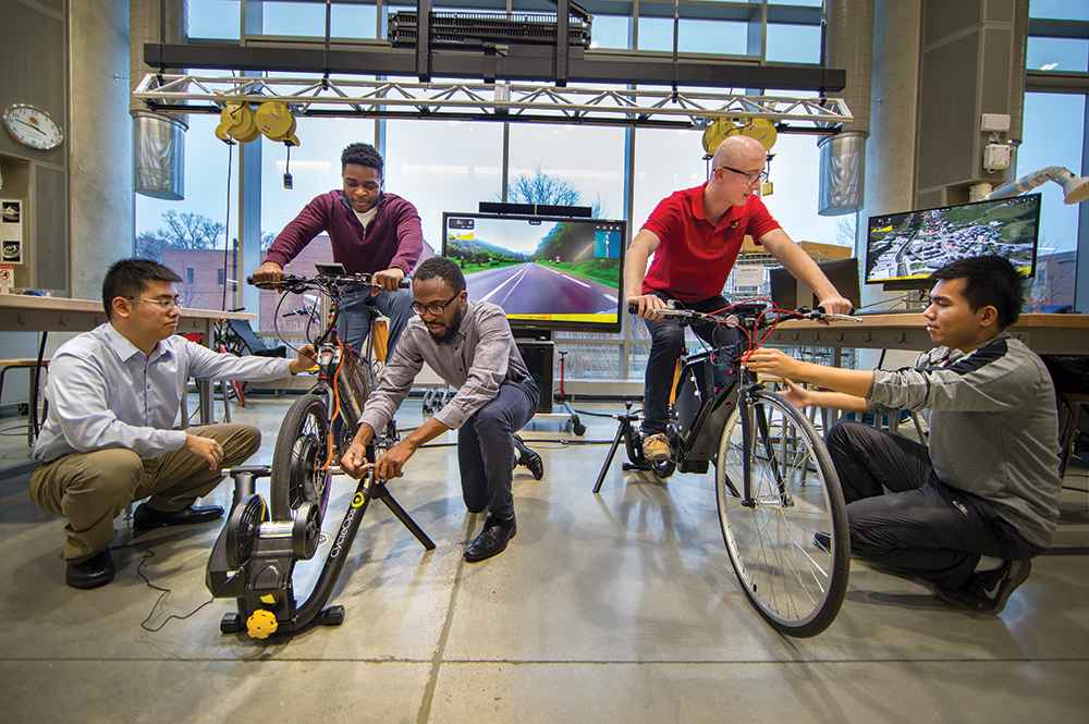 Student teams test their e-bikes on indoor trainers. Photo: John T. Consoli