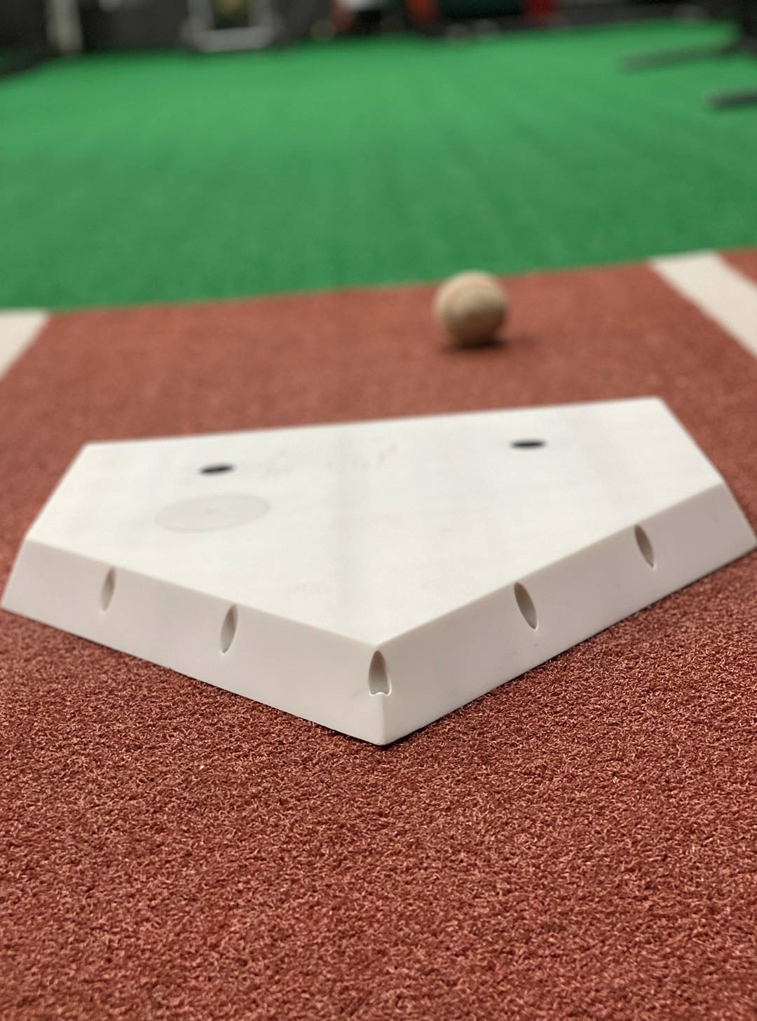 The camera from Plate Vision, the electronic home plate (below) developed by UMD researchers John R. Rzasa and Christopher C. Davis and CEO Todd Levitt, captures a bat striking a ball for a hit. (GIF and photo courtesy of John R. Rzasa and Todd Levitt)