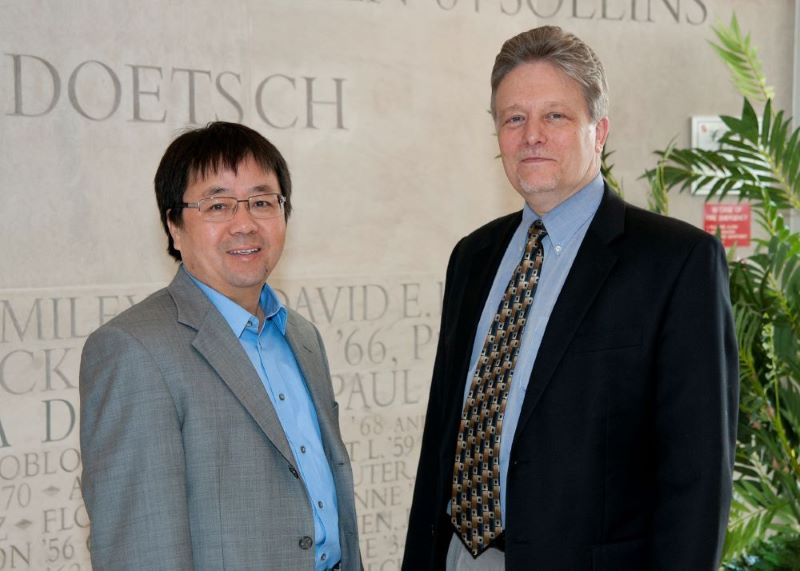 UMD Profs Chunsheng Wang and Eric Wachsman at an earlier CREB meeting.
