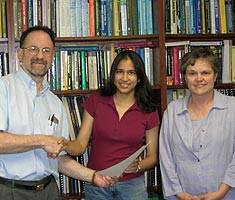 ECE Chair Steve Marcus with Divya Jhalani and ECE Undergraduate Studies Director Judith Bell