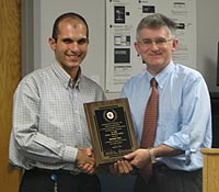 Mohamed Fahmi (left) with ECE Chair Patrick O'Shea (right)