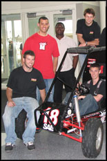Clockwise from left, Terps Racing students with last year's all-terrain baja vehicle:  Dale Cornette, Bryson Stewart, Obafemi Ogunosunfisan, Michael Mennucci and Ryan Zumbrun (seated).