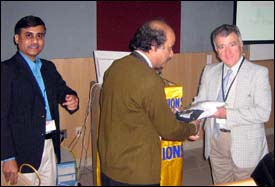 In Kolkatta, Ephremides (right) is presented with a memento of his visit to India.