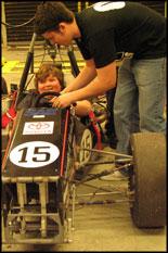 Terps Racing team member Mark Bellingham assists Beltsville Scout in the 2007 formula car.