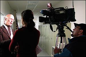 Associate Professor Ray Phaneuf (far left) being interviewed by CTV76's Saadia Van Winkle (center).