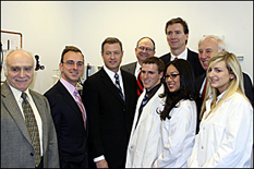 Pictured: (top row, left to right: Herbert Rabin, acting dean, A. James Clark School of Engineering; Scott Laughlin, former director of Mtech's VentureAccelerator Program; Governor Martin O'Malley; Zymetis President and CEO Steve Hutcheson; Steve Davey, Chief Operating Officer of Zymetis. Bottom row, in lab coats (all recent UM alumni) Dan Forrest; Elizabeth Santos; Kristen Goff.