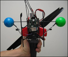 Students developed a method to control this coaxial helicopter fitted with a lightweight Inertial Navigation Unit and Bluetooth transceiver from the ground, using wireless communications from the ground robot. (Photo by Gil Blankenship/Clark School)