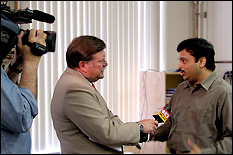 Professor Srinivasa Raghavan (right) explains why Remedium's product is an improvement over others currently on the market to a WJZ reporter.
