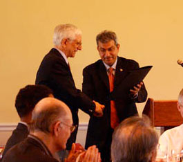 University of Maryland Provost Nariman Farvardin (right) was on hand to present Dr. Steven Tretter (lefT) with a signed letter of honorary citation from Maryland Governor Martin O'Malley. Photo by Jess Molina.