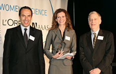 Sandra Ugrina receiving award from L'Oréal USA President and CEO Laurent Attal and National Academy of Sciences President Ralph Cicerone