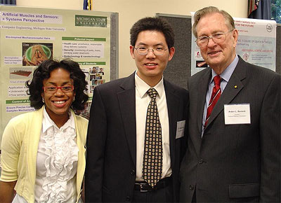 ECE alumnus Prof. Xiaobo Tan (center) with MSU Ph.D. student Dawn Hedgepeth (left) and National Science Foundation Director Dr. Arden Bement (right).