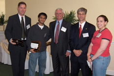 John Fisher, Parth Modi and Jennifer Lynn Moreau accept the 2005 Life Science Invention of the Year award from UM Division of Research Vice President Jacques Gansler and OTC Executive Director James A. Poulos III.
