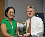 The Department of Electrical and Computer Engineering Staff Award was presented to Tracy Chung (left) with ECE Chair Patrick O'Shea (right).