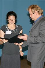 Daphne Fuentevilla, left, receiving her award.