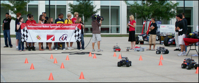 A television crew from WTTG Fox 5 in Washington, D.C., films students' robots live from the Kim Building plaza.