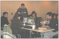 From Left: Winning team members Brian Doyle, Jenny Lees, Phillip Weisberg, Derek Willemstein, Alexander Tran and Mike Couture work during the Game Jam.