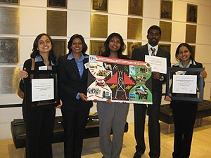 The TSAN Board displays their awards and winning poster.