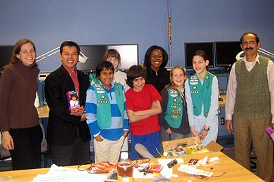 Girl Scouts team poses with ECE Professor Mel Gomez and ECE Laboratory Manager Shyam Mehotra