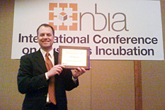 Tim Askew, CEO of CSA Medical, receiving the Outstanding Incubator Client award.