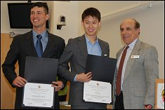 """Gabe Affandy and Charlie Choe receive the """"Department Chair's Award for Leadership and Service"""" from presenter Dr. Bigio."""